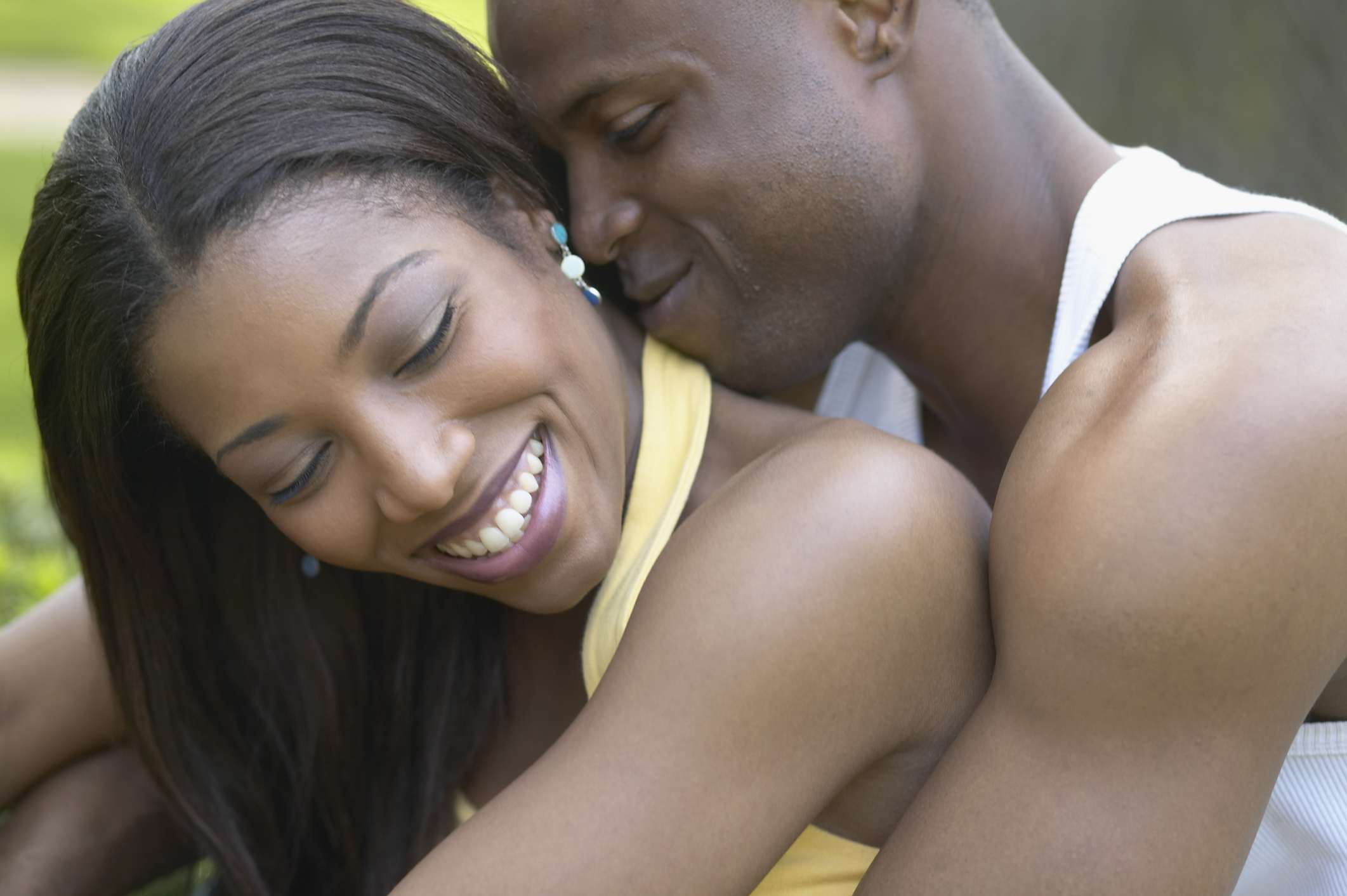 Close up of African couple hugging outdoors