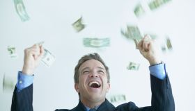 Excited Businessman Throwing Money