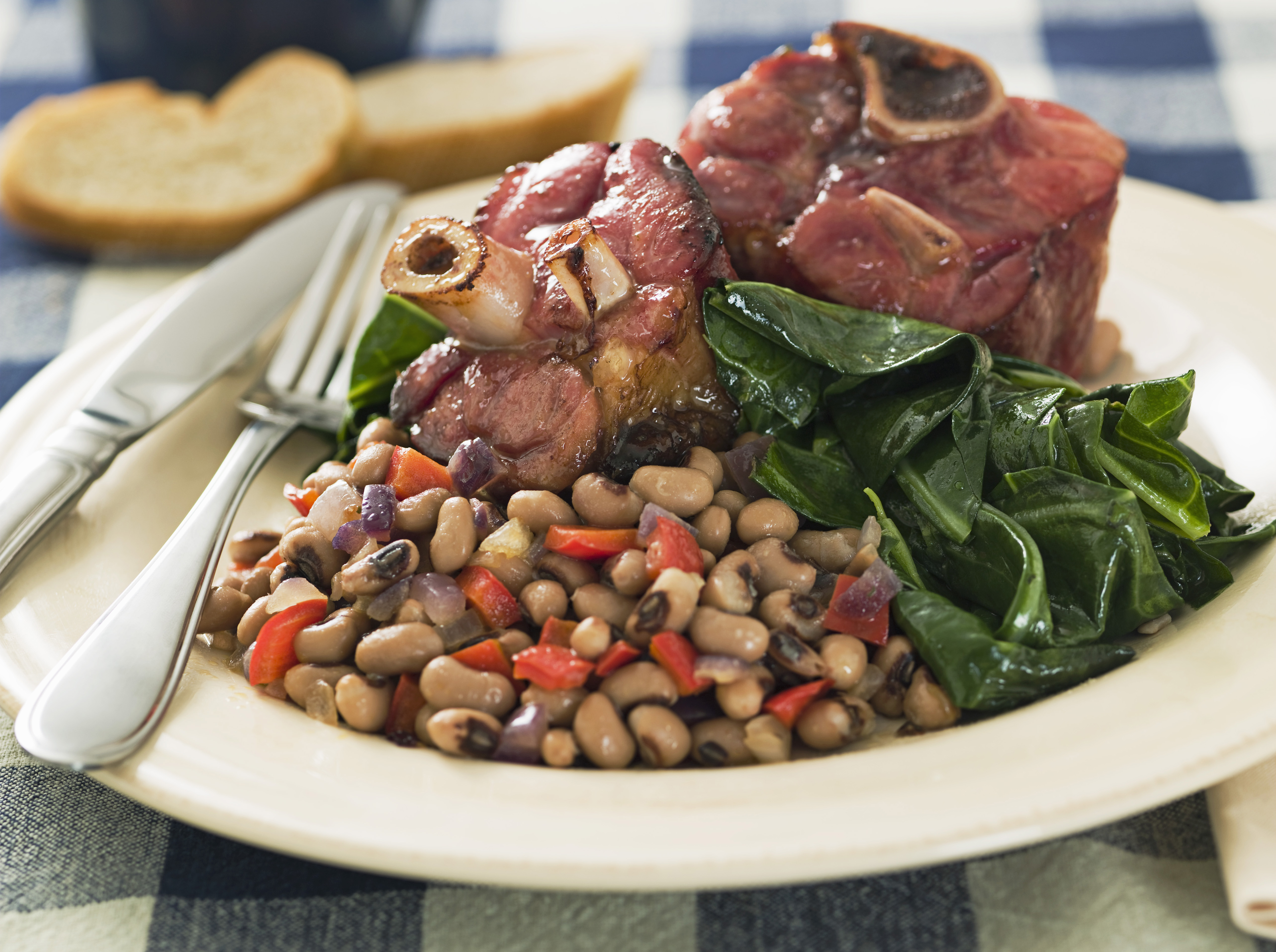 Southern New Year's meal with greens, beans, and ham hocks