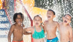 Multi-ethnic children at a water park
