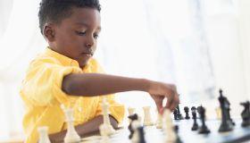 Boy (6-7) playing chess