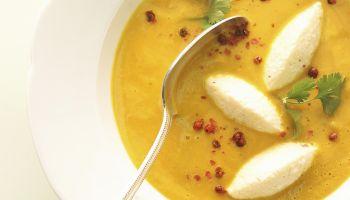 Coconut pumpkin soup with semolina dumplings, close-up