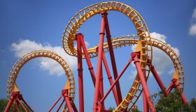 A Colorful Looping Roller Coaster On A Beautiful Sunny Day