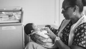 Nurse Holding Newborn Baby At Hospital