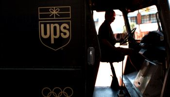 FI.UPS.silhouette.0801.AAG––United Parcel Service deliveryman Ken Malek starts up his van to continu