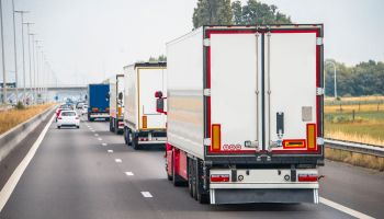 Trucks in a row on a highway