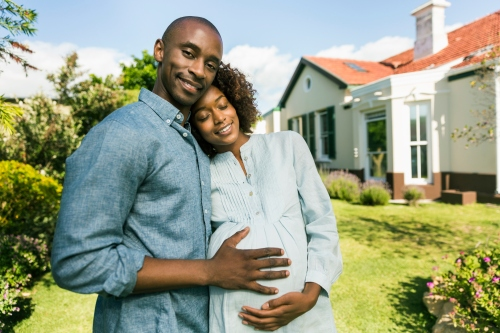 Loving man with pregnant woman in yard