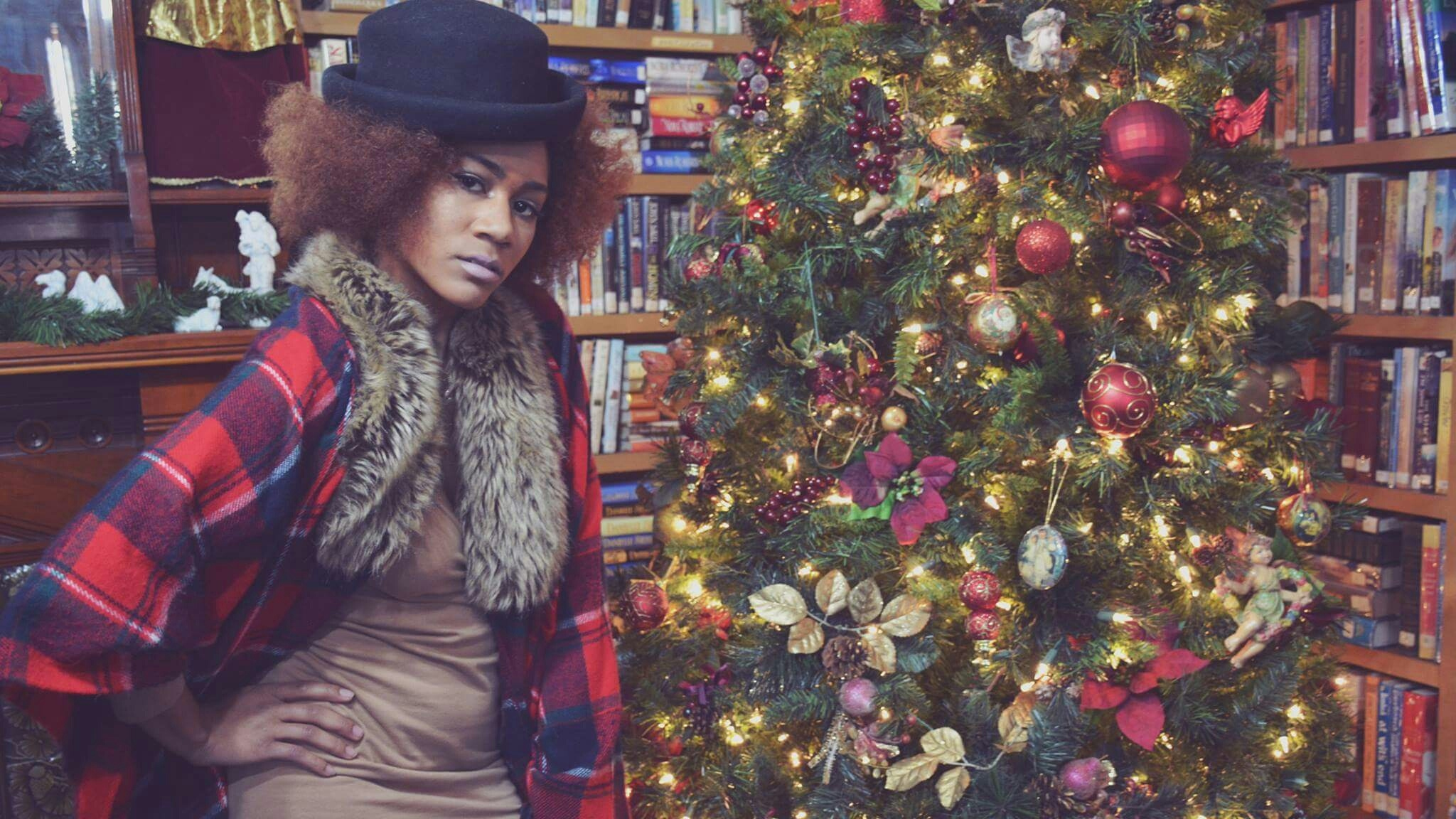 Portrait Of Woman Standing By Christmas Tree