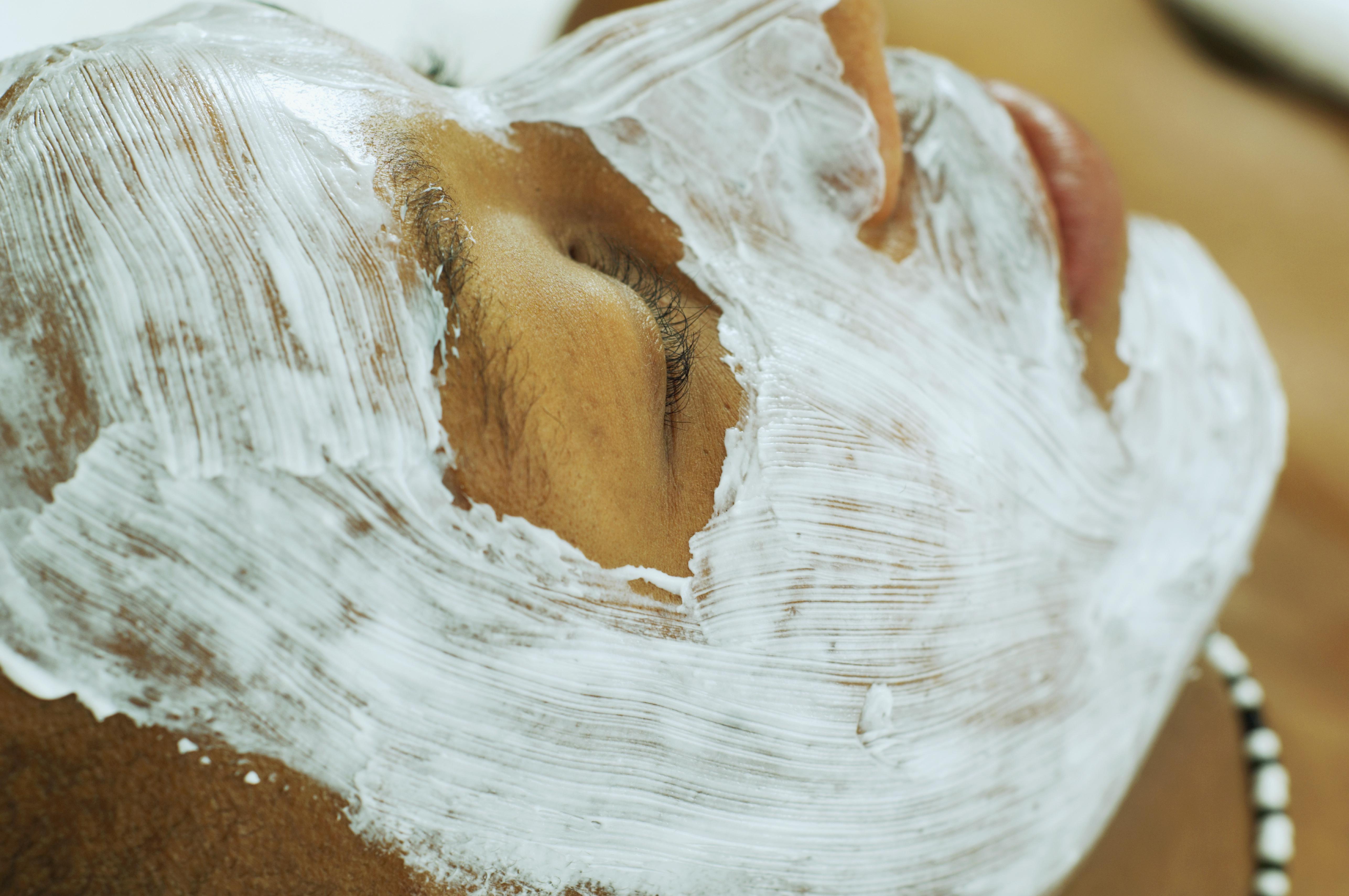 African man receiving spa facial treatment
