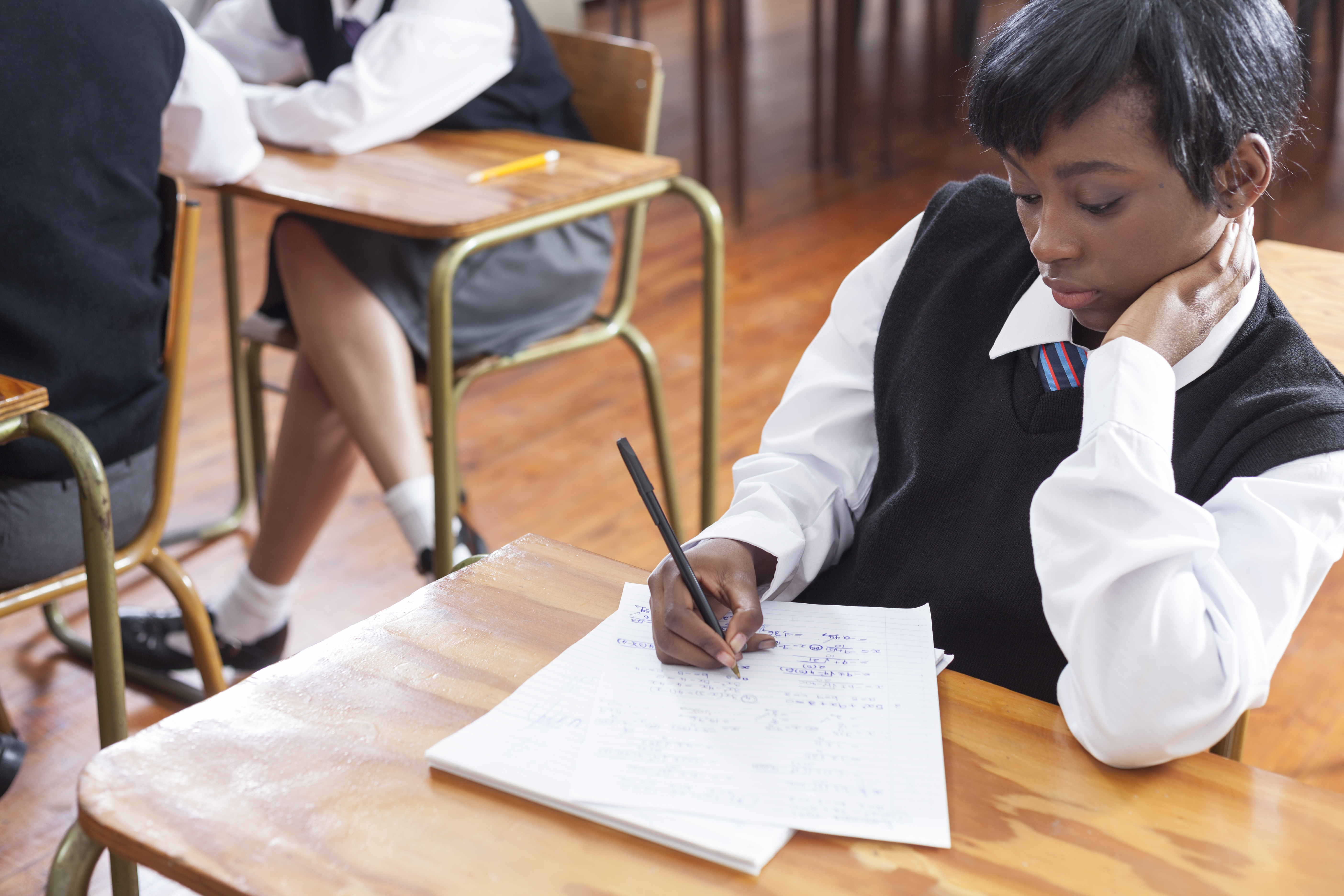 Student practicing maths in the classroom, Cape Town, South Africa