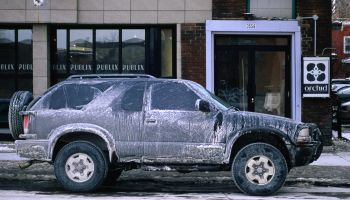 Dirty car in winter. Roads are salted to keep snow and ice at bay, but inevitably cars get rusty.