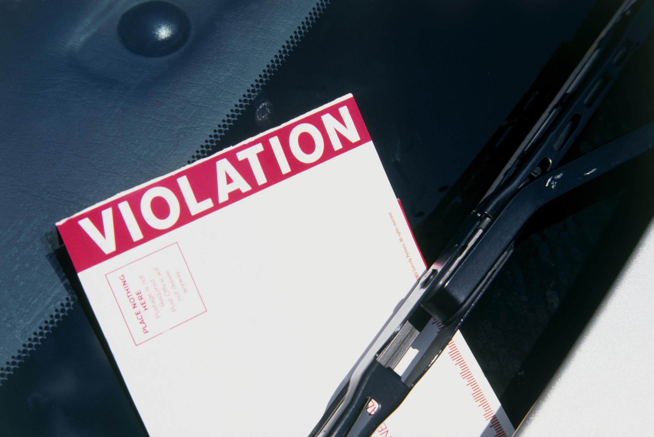 Parking ticket on a windscreen wiper