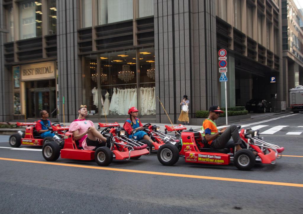 People driving karting cars dressed in super Mario, Kanto region, Tokyo, Japan...