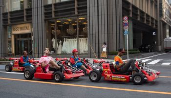 People driving karting cars dressed in super Mario, Kanto region, Tokyo, Japan...