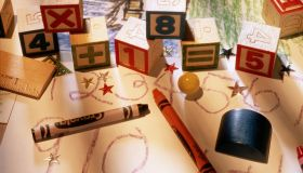 Child's drawings, crayons and blocks, elevated view