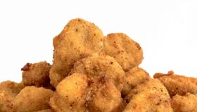 Close up of Chicken Nuggets over a white background. Healthy...