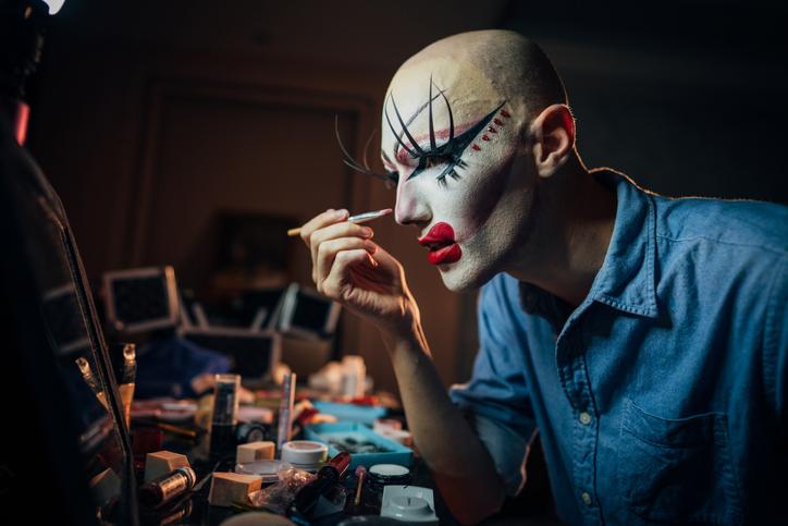 Transsexual man putting make up