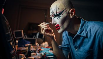 Transsexual man putting make up