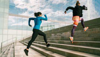 Sportswomen sprinting in the city