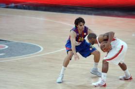 Regal Barcelona's Victor Sada (L) vies w