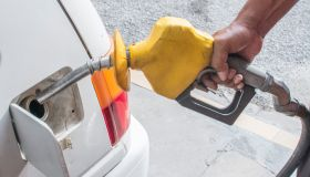 Cropped Hand Refueling Car At Gas Station