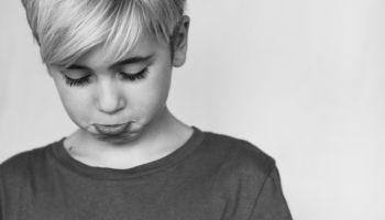 Boy making sad face