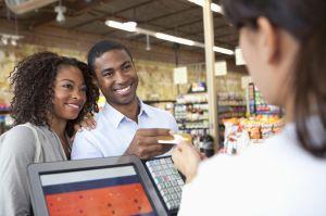 Couple buying groceries in supermarket