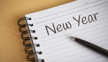 Close up of New Year Written on Notebook Corner