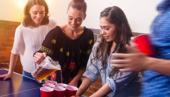 young adults Pouring drinks at a party