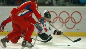 TURIN, ITALY. WEDNESDAY, FEBUARY 22, 2006. The Winter Olympics mens hockey quarterfinals are going on.Russia faced Canada at the Torino Esposizioni. In the first period Russian player #61 Maxim Afinogenov (hidden) takes down Canadian player #12 Jarome Igi