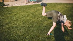 Boy attempting a cartwheel