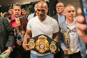 Mike Tyson shows off WBA belt during Mayweather/Pacquiao weigh-in