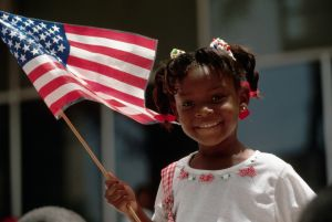 Girl Holds American Flag for Fourth of July